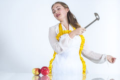 Cinderella. Photo of dreaming homemaker in kitchen on white background royalty free stock images