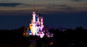 Cinderella's Castle lit up in rainbow colors. Cinderella's Castle lit up in rainbow colors at Walt Disney World's Magic Kingdom in Orlando, Florida Royalty Free Stock Images