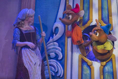 Cinderella talking to mice. GREEN BAY, WI - FEBRUARY 10: Cinderella in rags talking to the mice at the Disney Princesses show at the Resch Center on February 10 Royalty Free Stock Photo