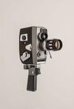Cine camera. A retro cine camera on a plain grey background Royalty Free Stock Photos