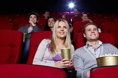 Cinema. Attractive people are watching a movie at the cinema Royalty Free Stock Photos