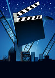Cinema. Movie clapper and twisted film for movie on blue Stock Photo