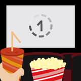 In the cinema. Sitting on the chair in the cinema with drink and popcorn Vector Illustration