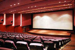 Cinema. Modern cinema interior with blank screen Royalty Free Stock Photos