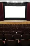 Cinema. Empty movie screen, red open curtain, wooden stage, wooden seats Royalty Free Stock Images