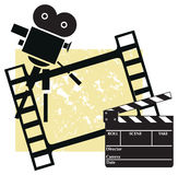 Cinema. Clapboard with a camera and filmstrip Royalty Free Stock Photo