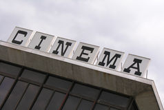 Cinema. Sign atop a movie theater Stock Images