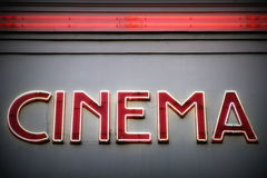 Cinema. Advertising red neon sign on a wall Royalty Free Stock Photos