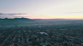Cinema aerial panoramic video of the night city from a helicopter. Beautiful sunset in Los Angeles, California, USA stock video