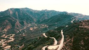 Cinema aerial panoramic video of the view of mountain formations in Malibu from a helicopter. Los Angeles, California stock video footage
