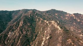 Cinema aerial panoramic video of the view of mountain formations in Malibu from a helicopter. Los Angeles, California stock video