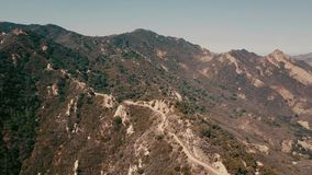 Cinema aerial panoramic video of the view of mountain formations in Malibu from a helicopter. Los Angeles, California stock footage