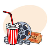 Cinema attributes, film reel, ticket, soda water in paper cup Royalty Free Stock Photography