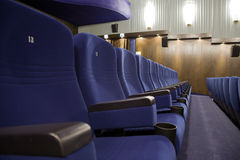 Cinema auditorium. Seat #13 in line of of cinema auditorium chairs Stock Images