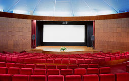 Cinema auditorium. Interior nobody red armchairs Stock Photos