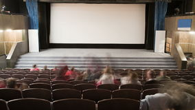 Cinema auditorium is crowding by people Royalty Free Stock Photo