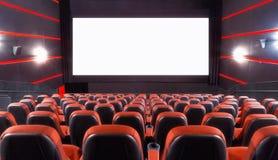 Cinema auditorium. Empty cinema auditorium with screen and seats royalty free stock photos