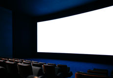 Cinema auditorium. With large screen and empty seats stock photography