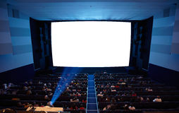 Cinema auditorium with light of projector. Stock Photos