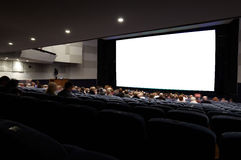 Cinema auditorium with people. Stock Photos