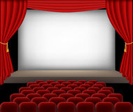 Cinema auditorium with red seats and curtains Royalty Free Stock Photography
