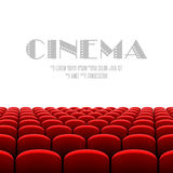 Cinema auditorium with white screen and red seats Royalty Free Stock Images