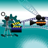 Cinema background. Abstract background with gears, movie camera, clapper board, filmstrip and film reel Royalty Free Stock Photography