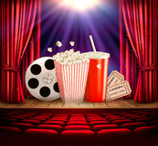 Cinema background with a film reel, popcorn. Drink and tickets. Vector stock illustration