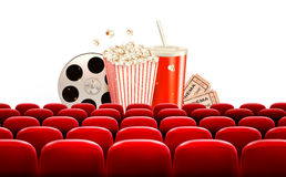 Cinema background with a film reel, popcorn, drink and tickets. Royalty Free Stock Image