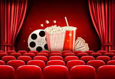Cinema background with a film reel, popcorn, drink and tickets. Vector Stock Photography