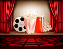 Cinema background with a film reel, popcorn, drink and tickets. Vector Stock Photo