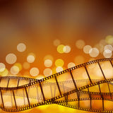 Cinema background with film strips and light rays Stock Photo