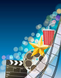 Cinema background with filmstrip, golden star, cup, clapperboard. On blurry blue background. vector Royalty Free Stock Photo