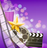 Cinema background with filmstrip, golden star, cup, clapperboard. On blurry purple background. vector Stock Photo