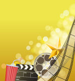 Cinema background with filmstrip, golden star, cup, clapperboard. On blurry yellow background. vector Royalty Free Stock Images
