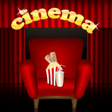 Cinema background. Cinema hall.red chair with a drink and popcorn on a background of portieres Stock Photo