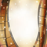 Cinema background. With retro filmstrip and stars as vertical borders Royalty Free Stock Photography