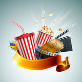 Cinema Banner. Popcorn box; disposable cup for beverages with straw, film strip, clapper board and ticket with ribbon banner. Detailed vector illustration. EPS10 Stock Photos