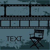 Cinema. Black silhouettes of a director chair with some negatives above it Royalty Free Stock Image