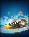 Cinema blue background. With retro filmstrip, clapper and star Royalty Free Stock Image