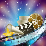 Cinema blue background with retro filmstrip. Clapper and stars Royalty Free Stock Image