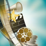 Cinema blue background. With retro filmstrip, clapper and stars left vertical border Royalty Free Stock Image
