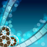 Cinema blue  background. With retro filmstrip, film reel Stock Photography