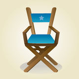 Cinema. A blue director chair on a light yellow background Stock Photo