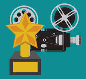 Cinema camera film and award trophy Stock Images