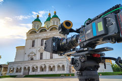 The cinema camera in front of the Cathedral of the Assumption of the Blessed Virgin Mary Royalty Free Stock Image