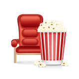 Cinema chair and popcorn isolated on white Stock Photography