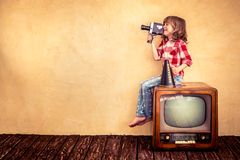 Cinema. Child playing at home. Kid making a film with retro camera. Cinema concept Royalty Free Stock Photo