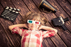 Cinema. Child playing at home. Kid with vintage cinema objects. Entertainment concept. Top view Stock Photos