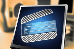 Cinema clap on blue background at monitor. 3D rendered Royalty Free Stock Image